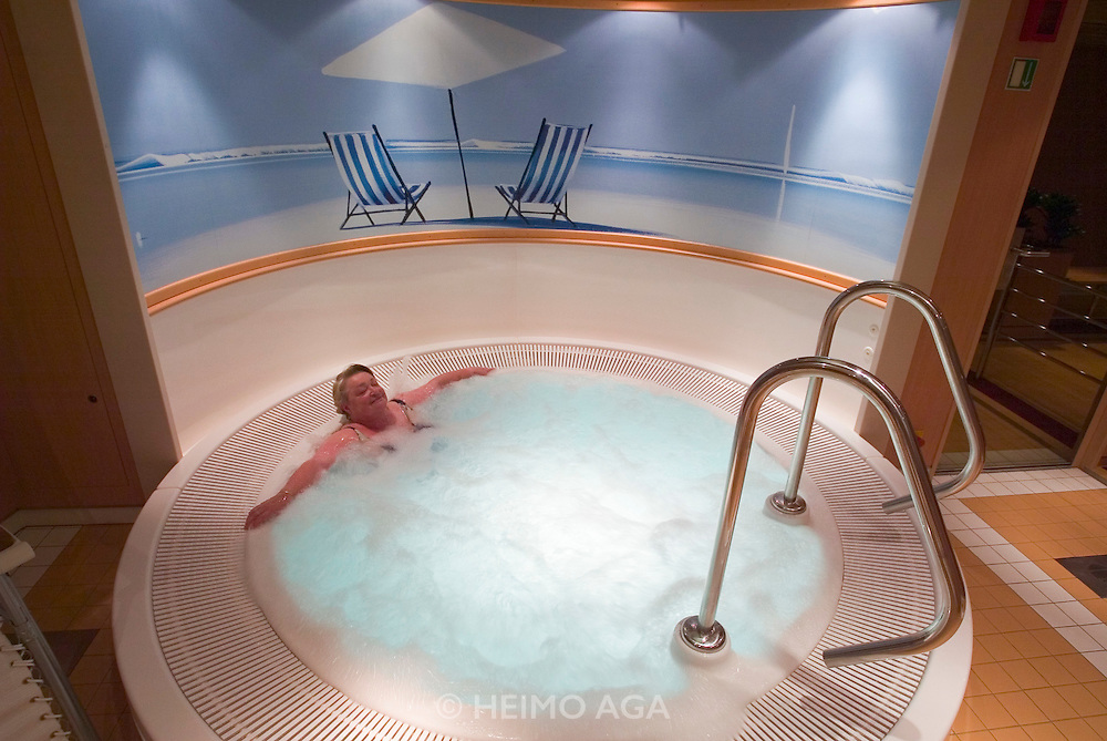 A passengers relaxes at the whirlpool...M.S. Johann Strauss, a brand new four star+ river cruiser operated by Austrian River Cruises, and chartered by Club 50 (a travel agency especially for seniors aged 50 and up) undertook an epic 3-week journey (May 21 to June 10, 2004) all the way from Amsterdam to the Black Sea?along Rhine, Main and Danube?, presumably the first passenger vessel ever to have done so. This is one of the images recorded during this historic voyage.