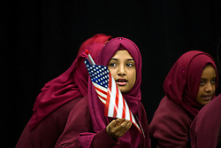 © Licensed to London News Pictures. 16/06/2015. London, UK. A student waving an American flag during a visit by Michelle Obama to Mulbery School For Girls in east London. Photo credit: Ben Cawthra/LNP