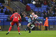 Wycombe Wanderers forward Alex Samuel challenged by Bolton Wanderers defender Aristote Nsiala during the EFL Sky Bet League 1 match between Bolton Wanderers and Wycombe Wanderers at the University of  Bolton Stadium, Bolton, England on 15 February 2020.