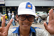 Á young man is wearing glasses similar to CNRP leader Sam Rainsy's  at an election campaign rally for opposing CNRP led by Sam Rainsy in Kampong Cham, Cambodia.