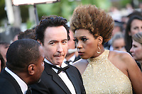 Lee Daniels,  John Cusack, Macy Gray, at The Paperboy gala screening red carpet at the 65th Cannes Film Festival France. Thursday 24th May 2012 in Cannes Film Festival, France.