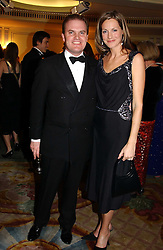 LORD DALMENY and the HON.CAMILLA ASTOR at a ball to celebrate the 50th anniversary of the charity 'Samaritans' held at The Dorchester Hotel, Park lane, London W1 on 15th February 2005.<br />