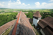 Viscri, Transylvania, Romania. There are several hundred Saxon villages in Transylvania, many of them with fortified churches. The village of Viscri is one of seven exceptionally well preserved examples which are inscribed on the UNESCO World Heritage List. © Rudolf Abraham