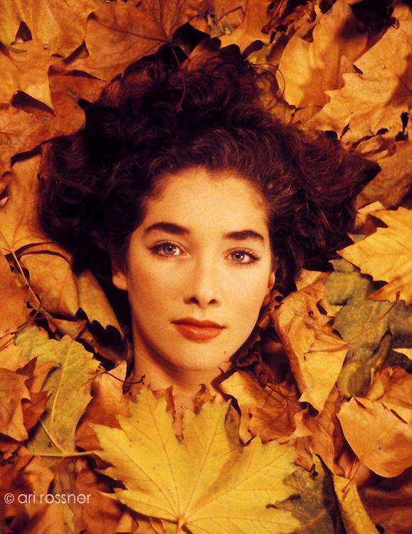 woman lying in dead leafs