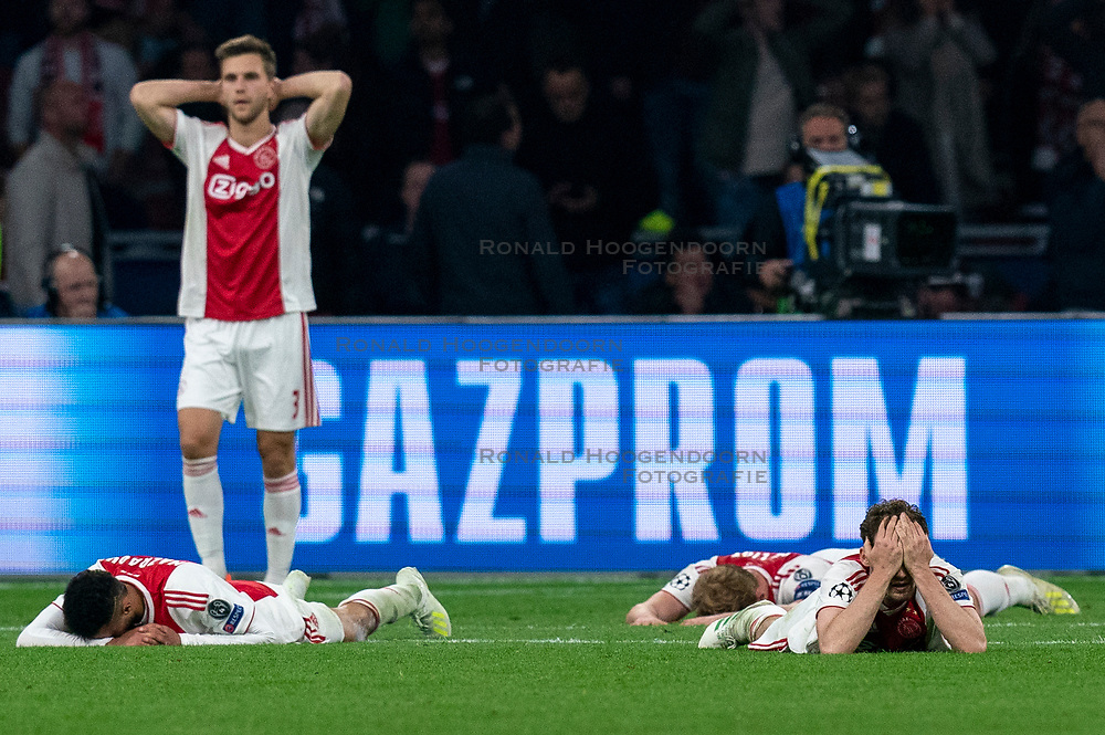 08-05-2019 NED: Semi Final Champions League AFC Ajax - Tottenham Hotspur, Amsterdam<br /> After a dramatic ending, Ajax has not been able to reach the final of the Champions League. In the final second Tottenham Hotspur scored 3-2 / Noussair Mazraoui #12 of Ajax, Joel Veltman #3 of Ajax, Daley Blind #17 of Ajax, Matthijs de Ligt #4 of Ajax