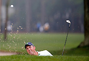 Matt Kuchar hits out of the bunker on the second green during the final round of the RBC Heritage golf tournament in Hilton Head Island, S.C., Sunday, April 19, 2015. (AP Photo/Stephen B. Morton)