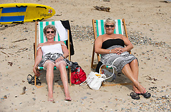 © Licensed to London News Pictures. 19/06/2013<br /> <br /> Saltburn Beach, Cleveland, England, UK<br /> <br /> Ann Ford (L) and her friend Mavis Smith from Stockton take it easy on the beach at Saltburn by the Sea in Cleveland on what could be the hottest day of the year so far.<br /> <br /> Photo credit : Ian Forsyth/LNP