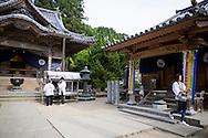 Pilgrims at the number 11 temple, Fujii-dera (藤井寺), at the Shikoku Pilgrimage, 88 temples associated with the Buddhist monk Kūkai (Kōbō Daishi) on the island of Shikoku, Tokushima Prefecture, Japan.