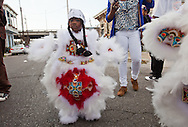New Orleans, Louisiana, February 21, 2012, Young girl in theYellow Pocahontas Mardi Gras Indians out on Mardis Gras Day in a traditional costumes.
