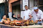 MARRAKESH, MOROCCO - November 06 2017 - Traditional mechoui - slow roasted lamb is served up daily at 'mechoui alley' in Marrakech, Morocco. <br />
