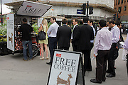 Lunchtime city workers queue for free coffee courtesy of The Economist magazine.