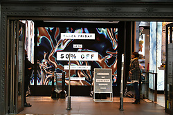 © Licensed to London News Pictures. 24/11/2017. London, UK. TOP SHOP Oxford Street in London almost empty shortly after 8am on the Morning of Black Friday sales. Many shops open early in the morning of Black Friday to offer offer promotional sales on items ahead of the Christmas period. Promotions have been scaled down in recent years after violence broke out at some shops between customers fighting for discounted items. Photo credit: Ben Cawthra/LNP