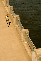 A young woman runs at the Waterfront Park in Portland, Oregon.
