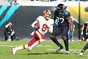 Dec 16, 2018; Jacksonville, FL, USA; Washington Redskins quarterback Josh Johnson (8) scrambles against the Jacksonville Jaguars during an NFL game at TIAA Bank Field. The Redskins beat the Jaguars 16-13. (Steve Jacobson/Image of Sport)