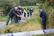 16/10/2007.Gardai pictured at the scene of the fatal stabbing in Grange near Clonmel..Picture Dylan Vaughan.