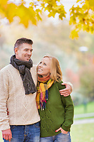 Portrait of Mature couple enjoying autumn while walking in park