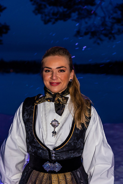 A  female guest at a Norwegian wedding wearing a bunad, the Norwegian National Costume, Trysil, Norway.