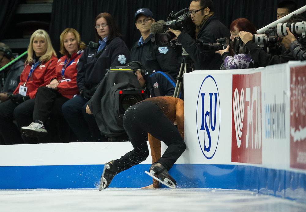 -20131019- Detroit, Michigan,USA--  <br />  Adam Rippon of the United States crashes into the boards during his free skate at Skate America 2013 in Detroit, Michigan, October 19, 2013. <br /> AFP PHOTO/Geoff Robins