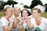 "Photo by Andrew Tobin/Tobinators Ltd - 07710 761829 - L-R Michelle Berry, Aimi Bresler, Emma Watson and Rachel Cross of the ""Brides to P"" team pose for a photo during the World Peashooting Championships held at Witcham, Cambridgeshire, UK on 13th July 2013. Run in conjunction with the village fair, the Championships have been held in Witcham since 1971 when they were started by a Mr Tyson, the village schoolmaster, in order to raise funds for the village hall.Competitors come from as far afield as the USA and New Zealand to attempt to win the event. The latest technology is often used, including laser sights and titanium and carbon fibre peashooters. All peashooters must conform to strict length rules, not exceeding 12 inches, and have to hit a target 12 feet away. Shooting 5 peas at a plasticine target attached to a hay bale, the highest scorers move through the initial rounds to a knockout competition, followed by a sudden death 10-pea shootout."