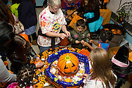 Middletown, New York  - Children decorate pumpkins during the Halloween Fall Festival at the Middletown YMCA Center for Youth Programs on Oct. 26, 2013.