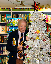 "Pictured: Alexander McCall Smith<br /> <br /> Today,  author Alexander McCall Smith joined customers at Blackwell's Bookshop in Edinburgh as they highlighted a scheme  which children involved with local charities hang ""book wishes"" and customers have the option to buy the book for the child who has requested it.<br /> <br /> Ger Harley 