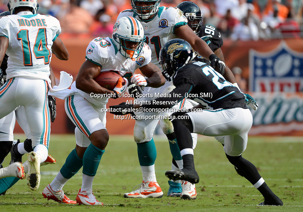 16 December 2012: Jacksonville Jaguars cornerback Mike Harris (20) tackles Miami Dolphins  running back Daniel Thomas (33) in Miami's 24-3 victory at Sun Life Stadium, Miami, Florida.