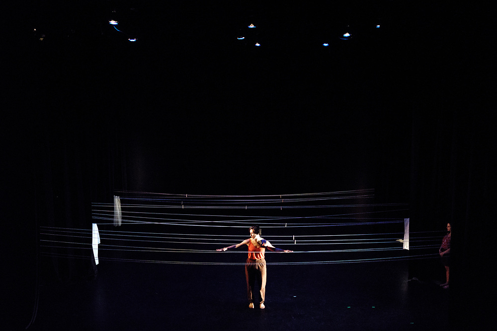 Baltimore, Maryland - April 25, 2017: Here is my home. (Lynne Price and Kristen Yeung, choreographers)<br /> This is an extension of a duet from last year.  It has a set piece which looks like hammock strings running from wall to wall.  <br /> Contemplating the relationship between architecture, scale, and the body while exploring the place-making process, emotional space, and anatomy of &quot;home.&rdquo;<br /> <br /> Baltimore modern dance company The Collective's annual concert &quot;This is Home&quot; at the Baltimore Theatre Project. <br /> <br /> <br /> CREDIT: Matt Roth