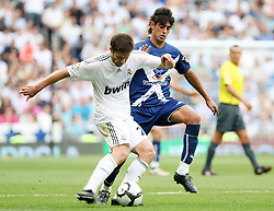 Real Madrid's Xabi Alonso (l) and Tenerife's Bellvis during La Liga match.September 2 2009.