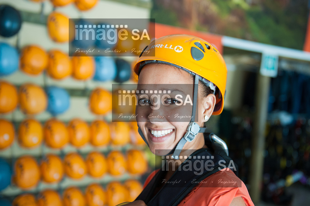 TSITSIKAMMA, South Africa: Friday 7 December 2012, Nelson Mandela Bay Tourism intern, Pamela Zondani, gets fitted out with her Merrell safety helmet during a media visit to the Tsitsikamma Falls and Adventures, along the Garden Route, Eastern Cape..Photo by Roger Sedres/ImageSA