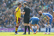 Burnley midfielder Joey Barton (13) has a warning from Referee Craig Pawson during the Sky Bet Championship match between Brighton and Hove Albion and Burnley at the American Express Community Stadium, Brighton and Hove, England on 2 April 2016. Photo by Phil Duncan.