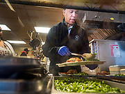 27 NOVEMBER 2019 - DES MOINES, IOWA: US Senator CORY BOOKER (D-NJ) plates up vegetables in the kitchen at Central Iowa Shelter and Services in Des Moines. Sen Booker helped plate up and serve lunch at the shelter. The shelter has about 180 beds and is full almost every night. In January and February, more than 250 people per night come to the shelter, which sets out overflow bedding. Senator Booker is running to be the Democratic nominee for the US Presidency in 2020. Iowa hosts the first selection event of the presidential election season. The Iowa caucuses are February 3, 2020.        PHOTO BY JACK KURTZ