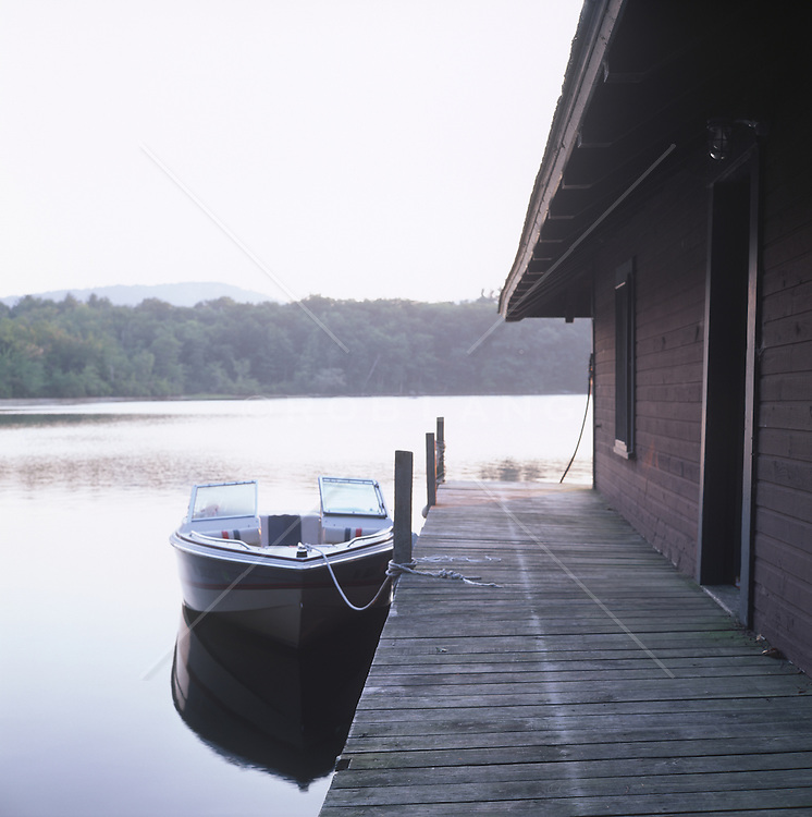 boat docked at a boat house on a lake in New Hampshire