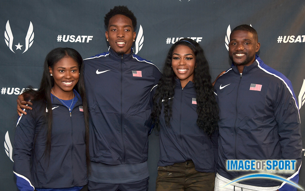 Apr 27, 2018; Philadelphia, PA, USA; Team USA members (from left) Aaliyah Brown, Michael Cherry, Raeven Rogers and Justin Gatlin pose at USA vs. the World press conference during the 124th Penn Relays at Franklin Field.