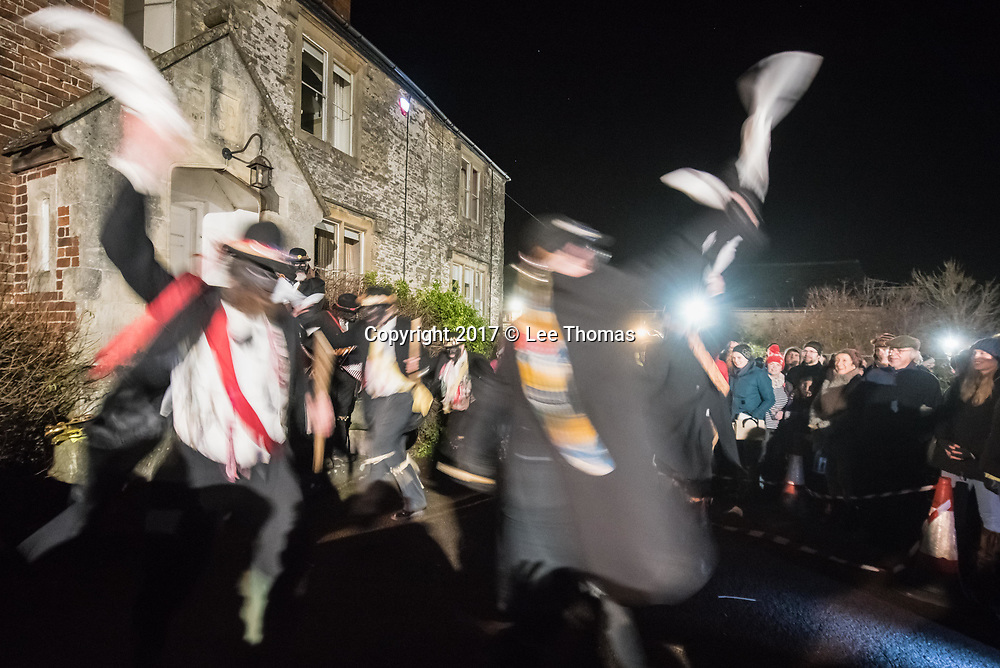 Much Marcle, Herefordshire, UK. 6th January 2018.  Pictured:  The Silurian morris side entertain the crowds outside Westons Cider Mill buildings. / Hundreds of people both young and old gathered at the Westons Cider Mill and adjoining orchard to take part in the traditional Wassail ceremony. The event at Much Marcle in Herefordshire was attended by the Silurian morris side who entertained the crowd with witty repartee, raucous dancing and music. According to their website, the true origins of blackened faces are lost to history, but are widely believed to be simply a form of disguise, possibly to overcome the oppressive anti-begging laws of the 17th century, and the eternal embarrassment of being a morris man. The orchard-visiting wassail refers to the ancient custom of visiting orchards in cider-producing regions of England, reciting incantations and singing to the trees to promote a good harvest for the coming year.  // Lee Thomas, Tel. 07784142973. Email: leepthomas@gmail.com  www.leept.co.uk (0000635435)