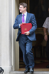 Downing Street, London, October 25th 2016. Secretary of State for Business, Energy and Industrial Strategy Greg Clark leaves10 Downing Street following the weekly cabinet meeting and the announcement that the construction of a third runway at Heathrow Airport has initial government approval.