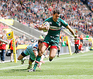 Picture by Andrew Tobin/Focus Images Ltd +44 7710 761829.25/05/2013. Niall Morris of Leicester goes past Jamie ELLIOTT of Northampton to score the first try during the Aviva Premiership match at Twickenham Stadium, Twickenham.