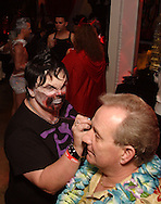 Michael Smith of Dayton gets a 'paint job' from Kelly Heuss of Toledo in the Red Ribbon Lounge during Masquerage 2010 in the Roundhouse at the Montgomery County Fairgrounds in Dayton, Saturday, October 16, 2010..