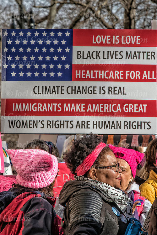 American Flag Sign at the Second Women's March.<br /> <br /> More than 200,000 protesters attended the march in New York on Saturday January 20,2018.  Thousands also turned out in Washington, Los Angeles, Chicago, Philadelphia, Rome and hundreds of other cities and towns.<br /> <br /> Women took to the streets of Manhattan  January 2018, in a show of solidarity with for the 2nd  Women's Day March to voice their anger again at President Trump.<br /> <br /> Both men and women attended rally on Central Park West before the start of the march holding signs in protest against President Trump.  <br /> <br /> Several speakers urged women to channel their energy into helping Democrats win races in the upcoming midterm elections. A rally called &ldquo;Power to the Polls.&rdquo;