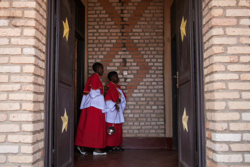 Two altar servers including Eugenie Mukayizera (right) prepare for the start of mass at The Shrine of Our Lady of Sorrows in Kibeho, Rwanda. This is the only sanctioned Marian sanctuary in Africa. Kibeho's overseers and the Rwandan government hope this place will become a top tourism site. <br /> <br /> Photographed on Sunday, October 26, 2014.<br /> <br /> Photo by Laura Elizabeth Pohl