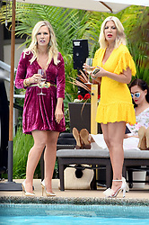 EXCLUSIVE: Tori Spelling and Jennie Garth back filming Beverly Hills 90210. The actors were back filming pool scenes while holding drinks pool side as the chatted and looked on at the pool wearing bright summer dresses. The 90210 new series is currently being filmed in Vancouver, Canada. 29 May 2019 Pictured: Jennie Garth, Tori Spelling. Photo credit: MEGA TheMegaAgency.com +1 888 505 6342