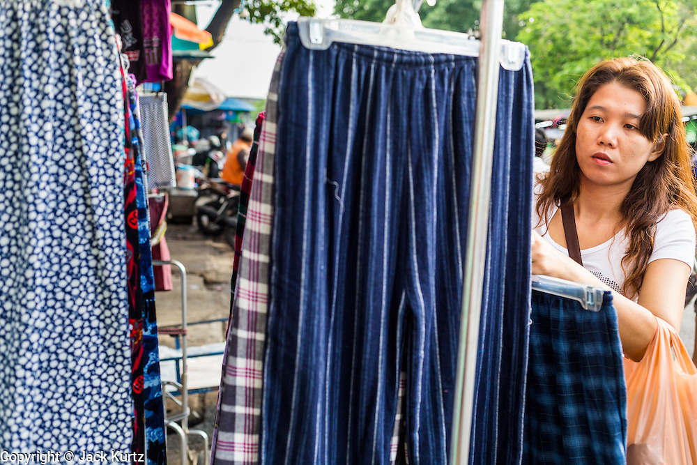 06 JUNE 2013 - BANGKOK, THAILAND:     A woman shops for clothes in Bobae Market in Bangkok. Bobae Market is a 30 year old market famous for fashion wholesale and is now very popular with exporters from around the world. Bobae Tower is next to the market and  advertises itself as having 1,300 stalls under one roof and claims to be the largest garment wholesale center in Thailand.       PHOTO BY JACK KURTZ