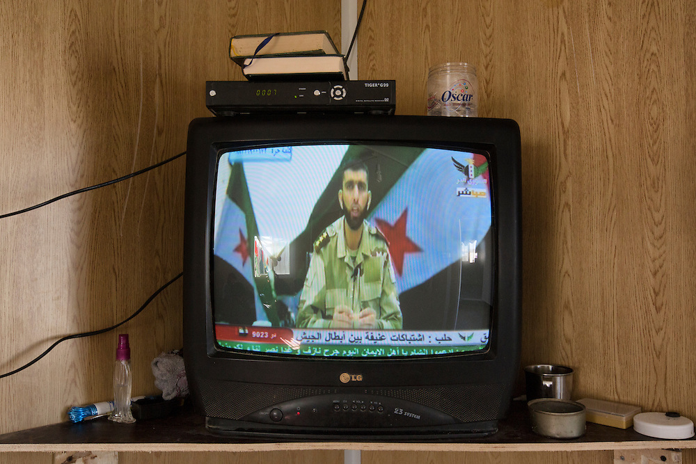 For those fortunate enough to have satellite capabilities, Free Syrian Army television broadcasts 24 hours a day providing news from the battlefront. Feb. 8, 2014. Zaatari Camp, Jordan. (Photo by Gabriel Romero/Alexia Foundation ©2014)