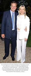 The MARQUESS & MARCHIONESS OF MILFORD HAVEN, at a dinner in London on 20th May 2002.	PAF 28