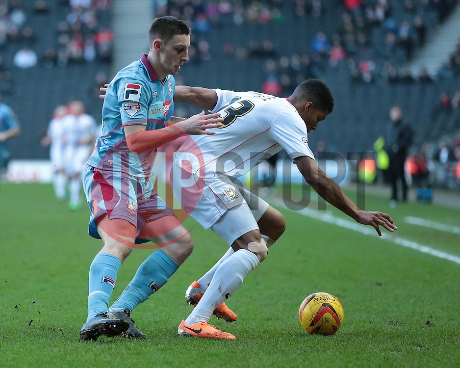 Milton Keynes Dons' Jordan Spence is challenged by Tranmere Rovers' Jake Cassidy - Photo mandatory by-line: Nigel Pitts-Drake/JMP - Tel: Mobile: 07966 386802 01/02/2014 - SPORT - FOOTBALL - Stadium MK - Milton Keynes - MK Dons v Tranmere Rovers - Sky Bet League One