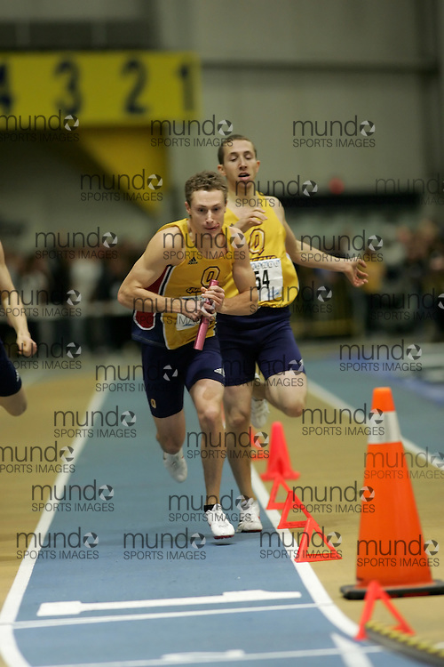 (Windsor, Ontario---13 March 2010) \54\ competes in the men's 4x400m relay final at the 2010 Canadian Interuniversity Sport Track and Field Championships at the St. Denis Center. Photograph copyright Sean Burges/Mundo Sport Images. www.mundosportimages.com