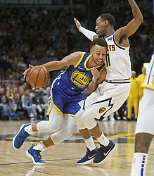 October 21, 2018 - Denver, Colorado, U.S - Warriors STEPHEN CURRY, left, makes a run to the basket with Nuggets MONTE MORRIS, right, during the 1st. Half at the Pepsi Center Sunday night. The Nuggets beat the Warriors 100-98. (Credit Image: © Hector Acevedo/ZUMA Wire)