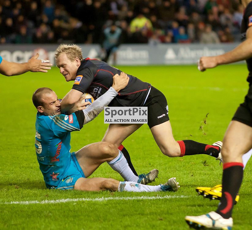 Ruggero Trevisan takes a knock as he tacles James King,Edinburgh Rugby v Aironi, Rabodirect Pro12