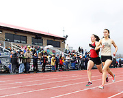 Penfield's Katie Lembo and Rush-Henrietta's Alex Cooper battle during the 1,500-meter run at the His and Her track and field invitational at Penfield High School on Saturday, April 26, 2014. Cooper won the race.