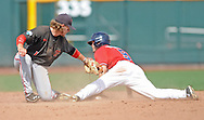 Mississippi's Auston Bousfield (9) steals second as Texas Tech's Tim Proudfoot (1) takes the throw at T.D. Ameritrade Park in the College World Series in Omaha, Neb. on Tuesday, June 17, 2014. Ole Miss won 2-1.