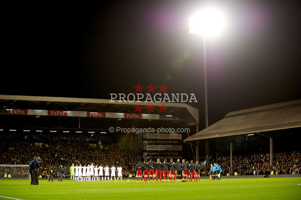 LONDON, ENGLAND - Monday, December 5, 2011: Fulham and Liverpool players stand to remember Wales manager Gary Speed, who died last week, before the Premiership match against Fulham at Craven Cottage. (Pic by David Rawcliffe/Propaganda)